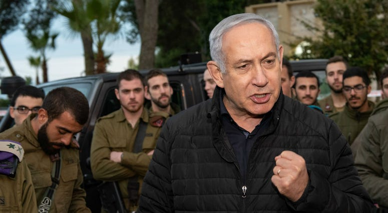 Israeli Prime Minister Benjamin Netanyahu seen with soldiers during a visit in the Northern Command Base at the northern Israeli town of Safed on December 11, 2018.