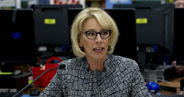 In this May 31, 2018 file photo, Education Secretary Betsy DeVos speaks during a visit of the Federal School Safety Commission at Hebron Harman Elementary School in Hanover, Md.