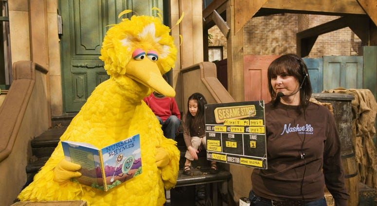 "In this April 10, 2008, file photo Lynn Finkel, stage manager for ""Sesame Street"" slates a taping with Big Bird in New York."