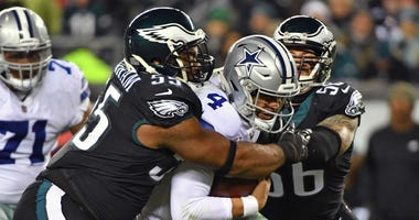 Philadelphia Eagles defensive end Brandon Graham (55) and defensive end Chris Long (56) sack Dallas Cowboys quarterback Dak Prescott (4) during the second quarter at Lincoln Financial Field.