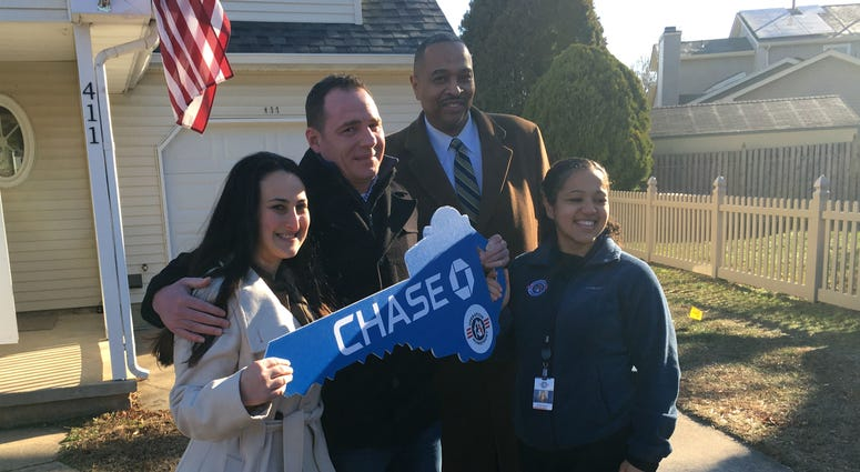 Brett Dawson, with his fiancée at far left, stands with representatives from J.P. Morgan Chase and Operation Homefront.