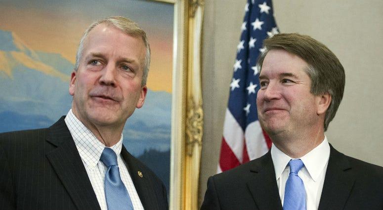 Supreme Court nominee Brett Kavanaugh, right, stands with Sen. Dan Sullivan, R-Alaska, before the start of their meeting, Thursday, July 12, 2018, on Capitol Hill in Washington.