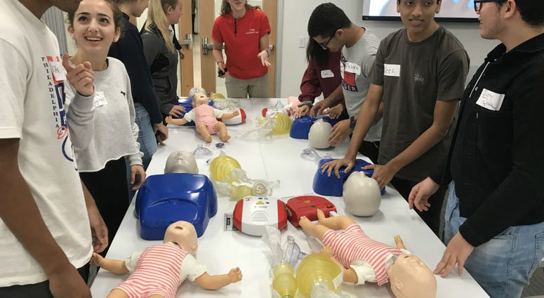 High school students get a training at University of the Sciences in assessing patients and treating opioid overdoses.