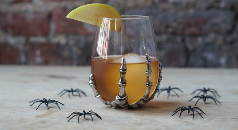 A seasonally appropriate caramel apple Old Fashioned, with some creepy crawlers to boot