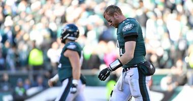Philadelphia Eagles quarterback Carson Wentz (11) walks off the field after fumbling on the final drive during the fourth quarter against the Carolina Panthers at Lincoln Financial Field