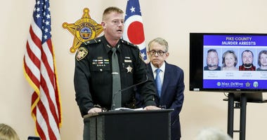 Pike County Sheriff Charles Reader, left, speaks alongside Ohio Attorney General Mike DeWine, right, during a news conference to discuss developments into the slayings of eight members of one family in rural Ohio two years ago.