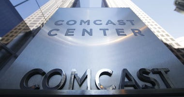 This March 29, 2017, file photo shows a sign outside the Comcast Center in Philadelphia. Comcast is reporting a stronger than expected second-quarter profit even as it struggles to keep cable TV subscribers.