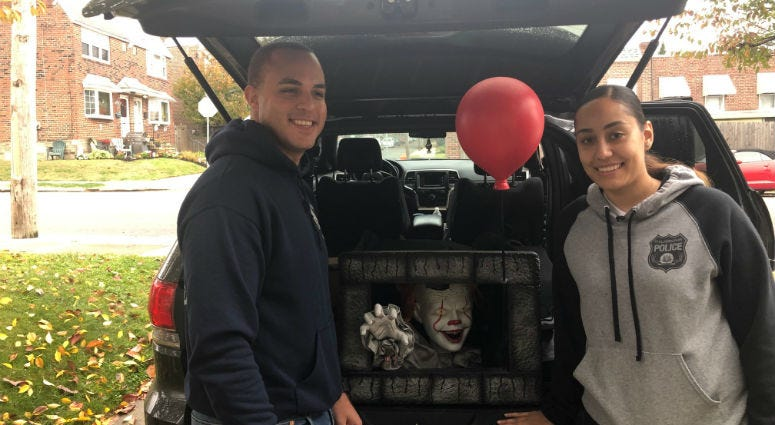 Philadelphia Police Officers Yesenia Rivera and Adrian Toribio show their 'Pennywise' Halloween props.