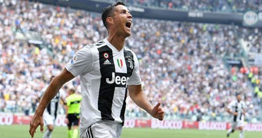 In this Sunday, Sept. 16, 2018 filer, Juventus' Cristiano Ronaldo celebrates after scoring during a Serie A soccer match between Juventus and Sassuolo, at the Allianz Stadium in Turin, Italy.
