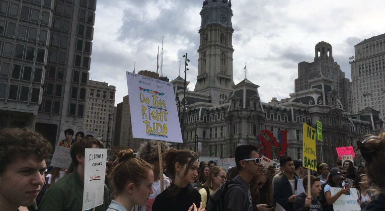 """Skipping school, teenagers rally at Love Park for the first-ever """"Youth Climate Strike."""""""