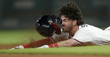 Atlanta Braves' Dansby Swanson slides into second base with a double during the seventh inning of the team's baseball game against the Philadelphia Phillies on Thursday, Sept. 20, 2018, in Atlanta.