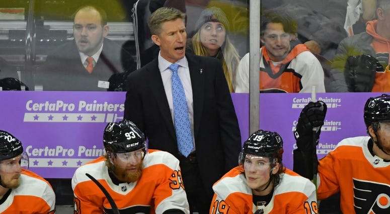 Philadelphia Flyers head coach Dave Hakstol behind the bench against the Ottawa Senators during the third period at Wells Fargo Center.