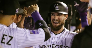 Colorado Rockies' David Dahl (26) is congratulated by teammates in the dugout after hitting a three run home run against the Philadelphia Phillies.