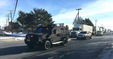 A SWAT vehicle arrives on the scene of a UPS facility in Logan Township following reports of an active shooter.