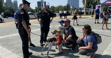 Philadelphia-area police officers were playing around in front of the Philadelphia Art Museum to promote next Tuesday's National Night Out.