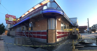 The Melrose Diner is closed and boarded up after a fire.