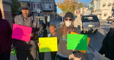 Protesters demand district abate asbestos at school