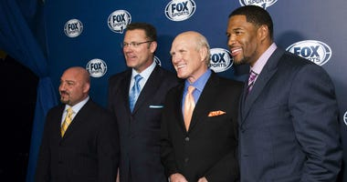 This March 5, 2013, file photo shows Jay Glazer, from left, Howie Long, Terry Bradshaw and Michael Strahan attending the Fox Sports Media Upfront party celebrating the new Fox Sports 1 network in New York.