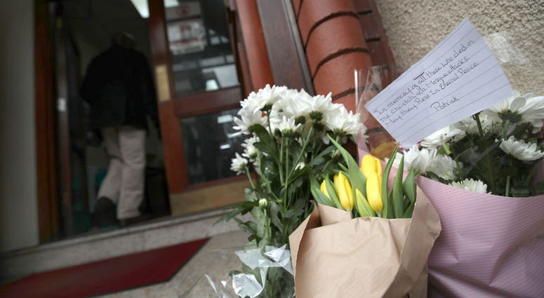 Flowers and a message left at Finsbury Park Mosque in London, following the Christchurch mosque attacks in New Zealand.