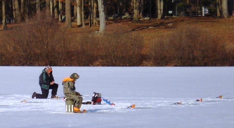 Men ice fish at Montgomery County's Green Lane Reservoir.