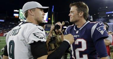 Philadelphia Eagles quarterback Nick Foles (9) and New England Patriots quarterback Tom Brady (12) speak at midfield after a preseason NFL football game, Thursday, Aug. 16, 2018, in Foxborough, Mass.