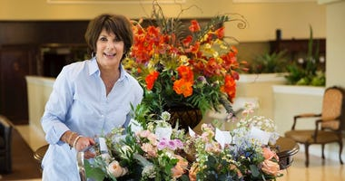 Leona Davis runs Forget Me Knot Flowers from her Haddonfield home, delivering donated wedding flowers to residents in nursing homes, cancer centers and women's shelters in the Philadelphia area.
