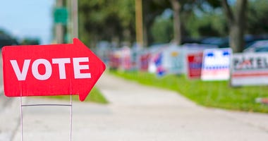 Sign directing voters.