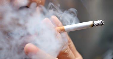 A person smoking a cigarette.