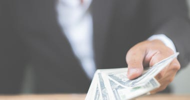 Businessman with cash in hand