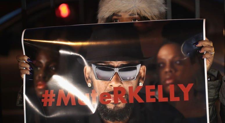 """Demonstrators gather near the studio of singer R. Kelly to call for a boycott of his music after allegations of sexual abuse against young girls were raised on the highly-rated Lifetime mini-series """"Surviving R. Kelly"""" on Jan. 9, 2019 in Chicago, Illi"""