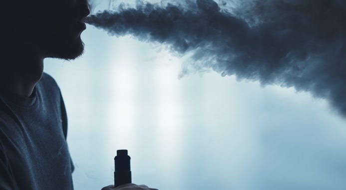 A man smoking an e-cigarette.