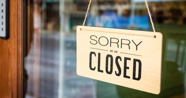 'Closed' sign on a store door