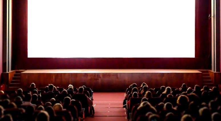 People watching a movie in a theatre.