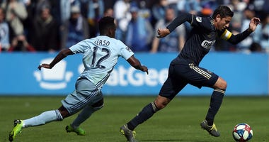Alejandro Bedoya #11 of Philadelphia Union controls the ball as Gerso #12 of Sporting Kansas City chases during the game at Children's Mercy Park on March 10, 2019 in Kansas City, Kansas.