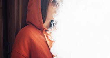 A girl vaping.