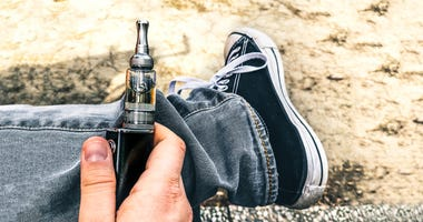 Young person using a vaping device.