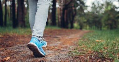 Woman walking along trail