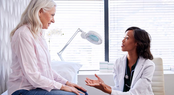 A woman talking to her doctor.