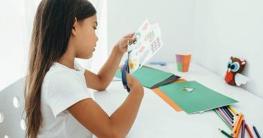 A girl doing an art project