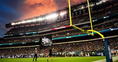 A Philadelphia Eagles flag-bearer flies the team logo after the first score of the game against the Tennessee Titans.