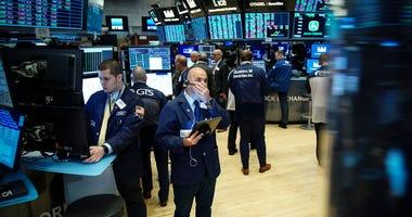 Traders and financial professionals work on the floor of the New York Stock Exchange (NYSE) at the opening bell on August 15, 2019 in New York City.