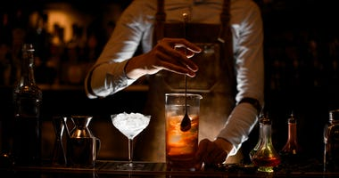A bartender making drinks.