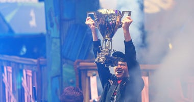 """Kyle """"Bugha"""" Giersdorf celebrates after winning the Fortnite World Cup solo final at Arthur Ashe Stadium on July 28, 2019 in New York City."""