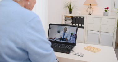A patient speaks to a doctor online