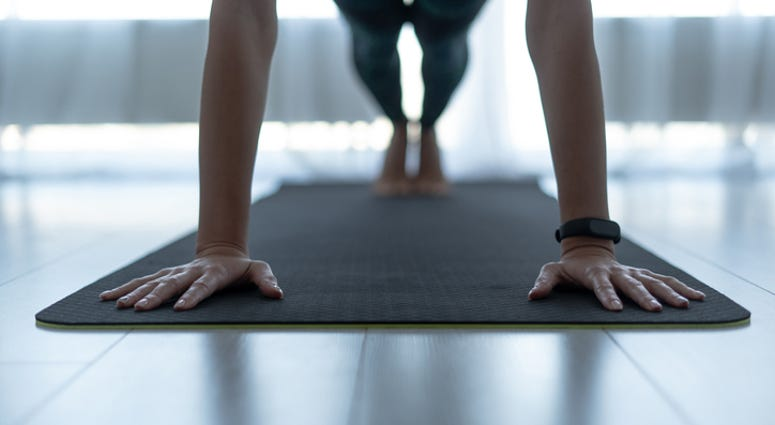 Woman exercising on fitness mat