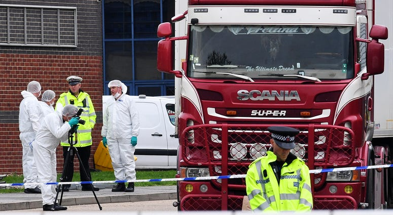 Police and forensic officers investigate a lorry in which 39 bodies were discovered in the trailer, as they prepare move the vehicle from the site on October 23, 2019 in Thurrock, England.