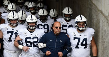 Head coach James Franklin of the Penn State Nittany Lions walks his team onto the field before playing against the Minnesota Golden Gophers.
