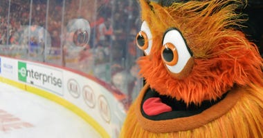 Gritty watches the game against the Ottawa Senators in the third period at Wells Fargo Center on December 7, 2019 in Philadelphia, Pennsylvania. The Flyers won 4-3.