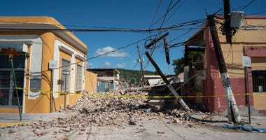 Rubble covers the street after a 6.4 earthquake hit just south of the island on January 7, 2020 in Guayanilla, Puerto Rico.