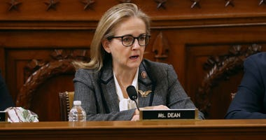 House Judiciary Committee member Rep. Madeleine Dean (D-PA) (L) votes for the second of two articles of impeachment against U.S. President Donald Trump.